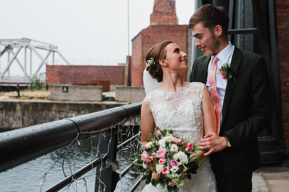 Jess and Ben - Liverpool wedding - bride and groom on the balcony