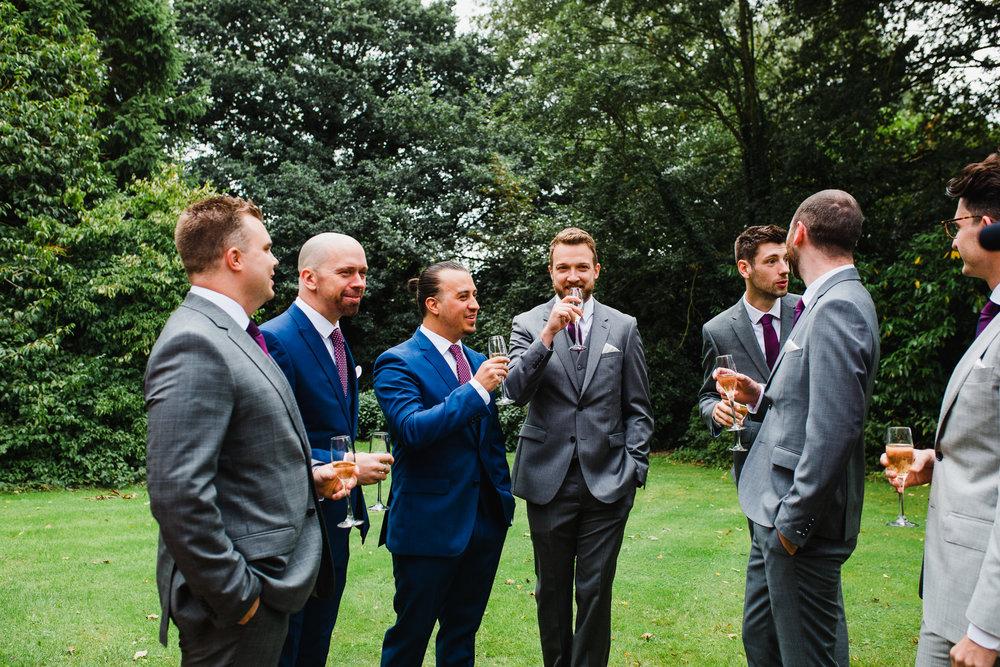 groom and groomsmen in the garden