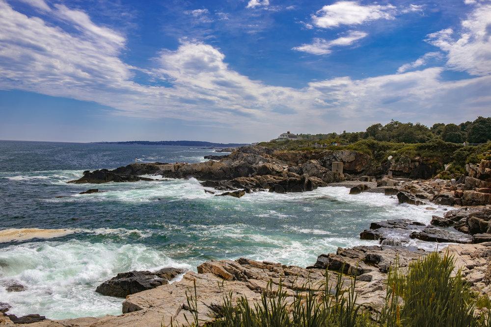 water crashing on rocky coastline