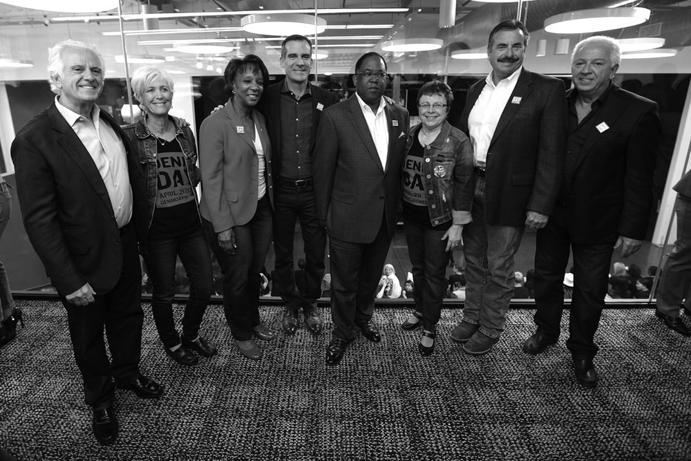 Maurice Marciano, Cathy Friedman, District Attorney Jackie Lacey, Mayor Eric Garcetti, Supervisor Mark Ridley-Thomas, Patti Giggans, Chief Charlie Beck & Paul Marciano at GUESS? Inc. Headquarters on April 29, 2015 in Los Angeles, California.