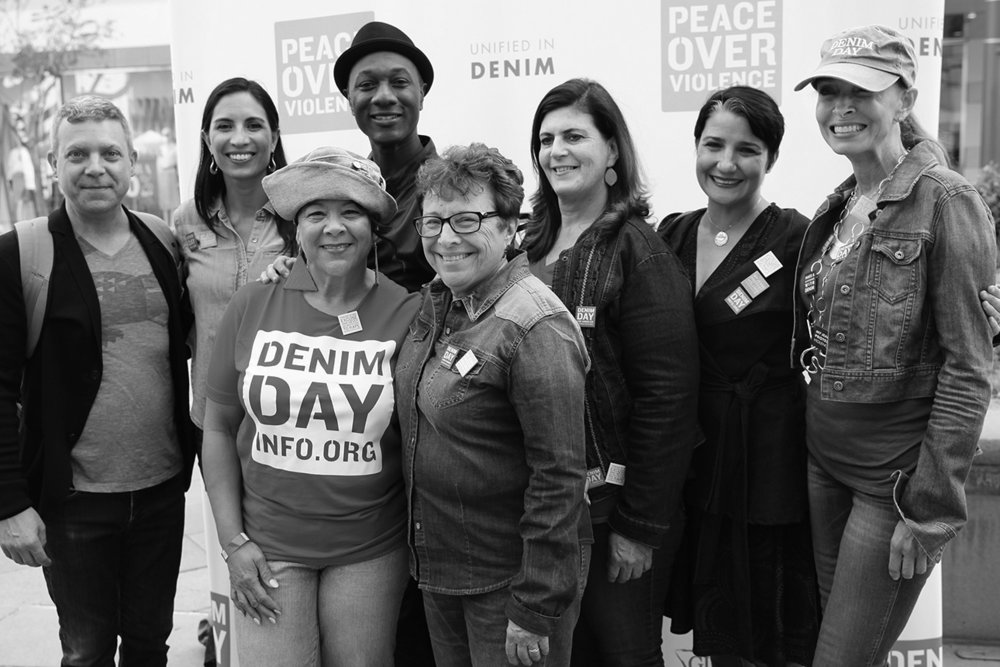 Executive Director Patti Giggans with Denim Day Spokescouple Maya Jupiter and Aloe Blacc, alongside POV Board President Kent Kiesey and Board Members: Char Bland, Dawn, Bey, Christina Mauro, and Advisory Board Member Michelle Santucci