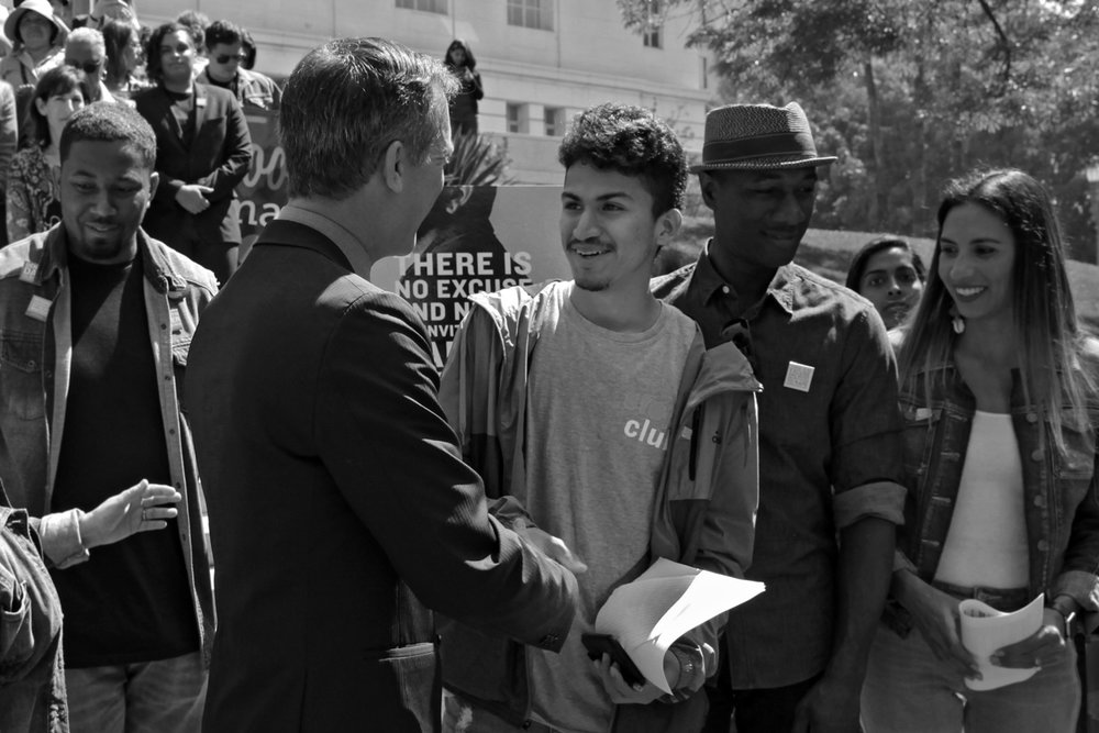 Alexis, Youth Over Violence Leader, shares a moment with Mayor Eric Garcetti..