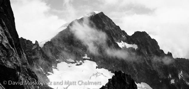 The massive west face of Eldorado Peak briefly poked out of the clouds while we were on Dorado Needle.