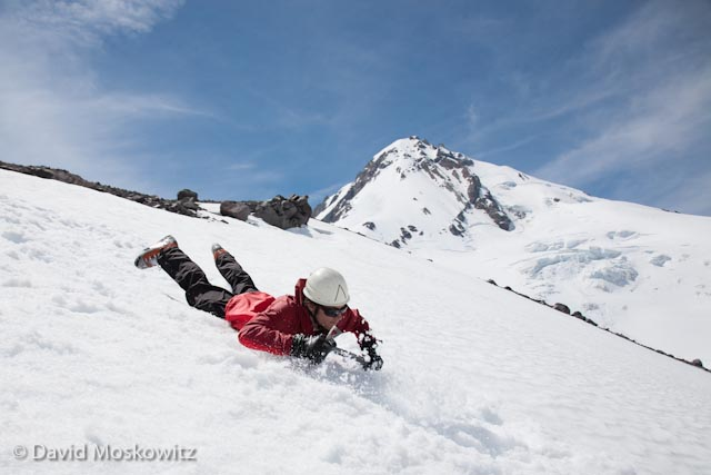 Outward Bound Instructor Sam Ecenia dives into Alpine Skills Training on Mount Hood to start of the summer field season for Northwest Outward Bound School's summer season.