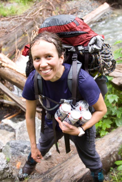 Soaking wet from a long descent in pouring rain, Samantha completes a successful trip with the safe retrieval of several cans of Pabst Blue Ribbon beer from the Cascade River.