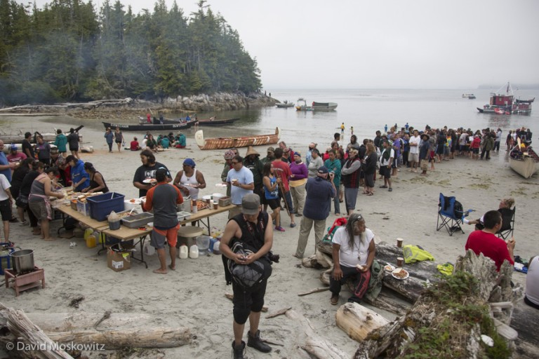 Along the route to Bella Bella, canoe families were often hosted for dinner and celebration by the nation whose traditional territory they passed. Here, members of about 20 canoes and their support boats came ashore and were hosted by the Wuikinuxv First Nation in a bay called Open Bight on the mainland coast of British Columbia.