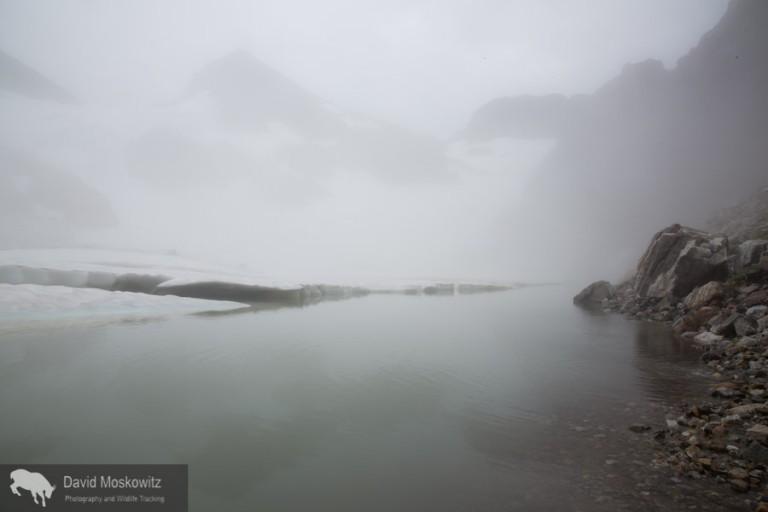 Lifting fog reveals hidden peaks.