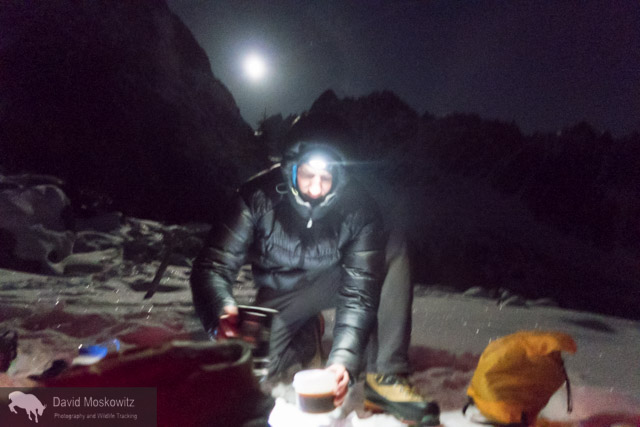 In the moonlight, Cam makes coffee for our pre-dawn start.