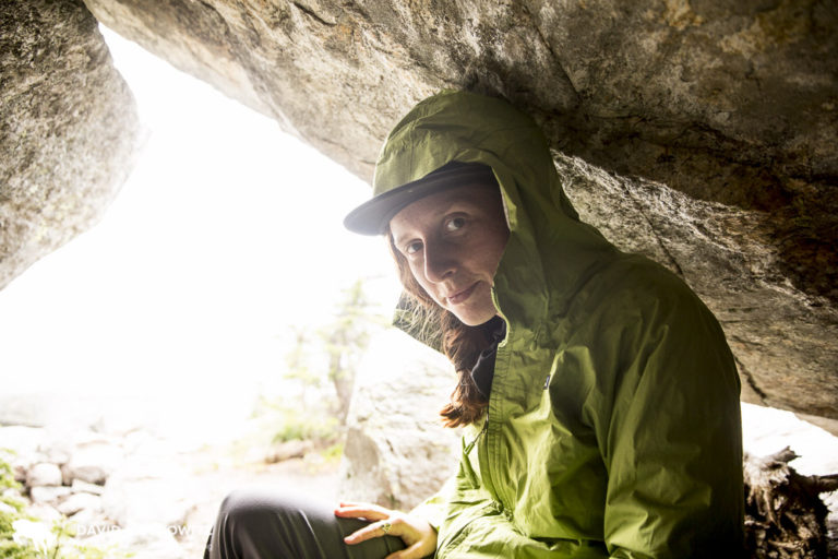 Kim Shelton seeks shelter from the rain this summer in the southern Selkirk Mountains close to the Washington-BC border.
