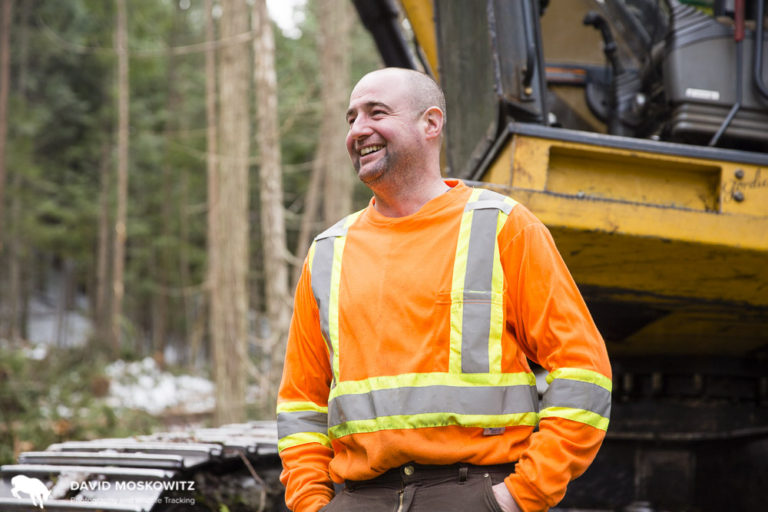 Gordie Hale takes a break from his work moving logs on a logging operation in the southern Selkirk Mountains.