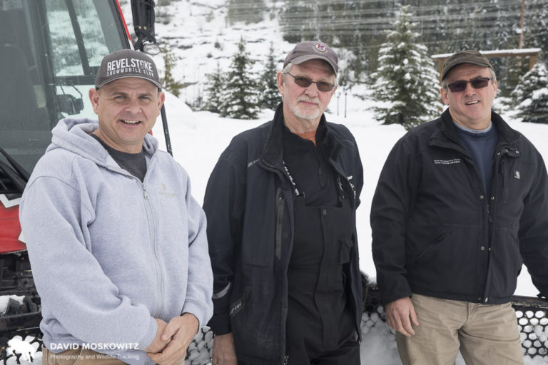 Revelstoke Snowmobile Club president Daniel Kellie along with two club members, lean on the club's new groomer close to the very popular Boulder Mountain trailhead, also the location of a dwindling number of mountain caribou.