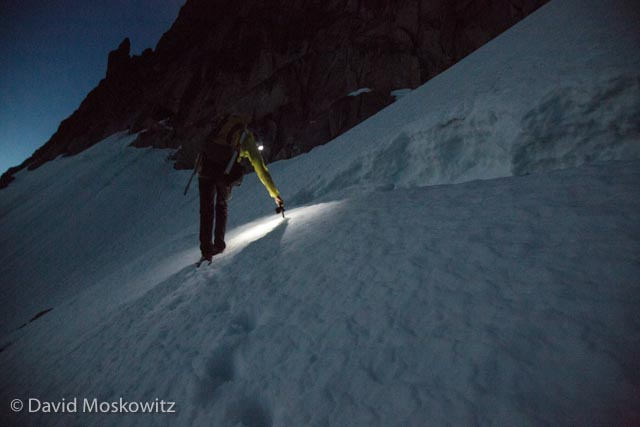 We crossed the Stuart Glacier in the dark, having left camp around 2 AM. Here Joel Reid navigates a crevasse on the glacier by headlamp.