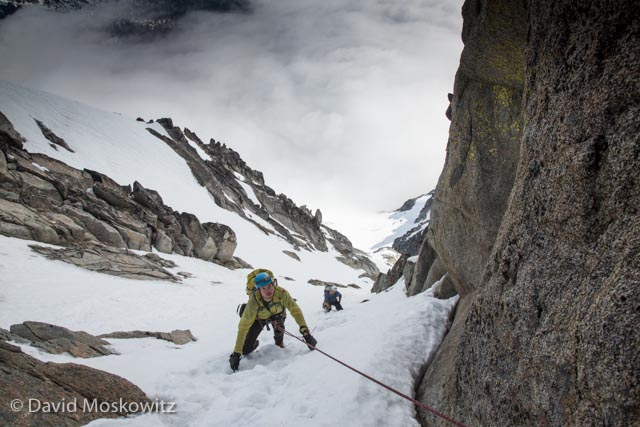 Joel and Trevor approach the top of the couloir on Mount Stuart's west ridge.