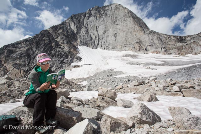Erin Smart reviews her climbing guide below Bugaboo Spire.