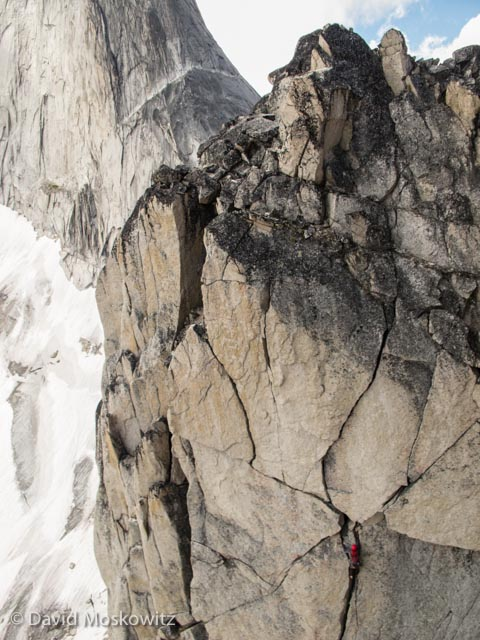 Jason Cramm on Paddle Flake Direct with the northeast ridge of Bugaboo Spire beyond.