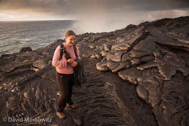 Darcy Ottey poses with the newest rocks on the planet. We watched the still slightly glowing pile of basalt to her left ooze out of a crack in the rocks and harden.