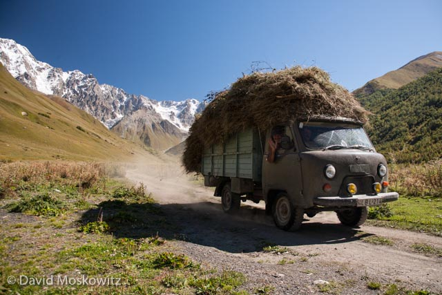 Hay being hauled out of the mountains to the village of Ushguli. Sveneti, Republic of Georgia.