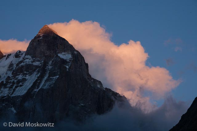 Though not the highest peak in the range, at 4,710 m (15,453 ft), Mount Ushba is a massive peak and generally considered the most challenging mountaineering objective in the range. Seen hear at sunset with a steady stream of clouds forming and streaming off of the lee side of the summit.