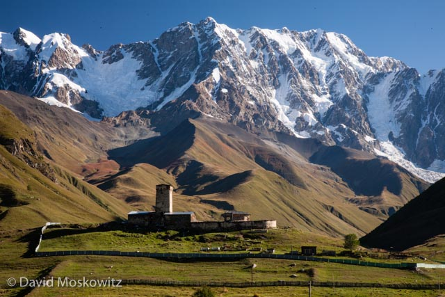 The Lamaria Church, near the town of Ushguli, with the southern face of Mount Shkhara, 5,193 m (17,040 ft), in the background.