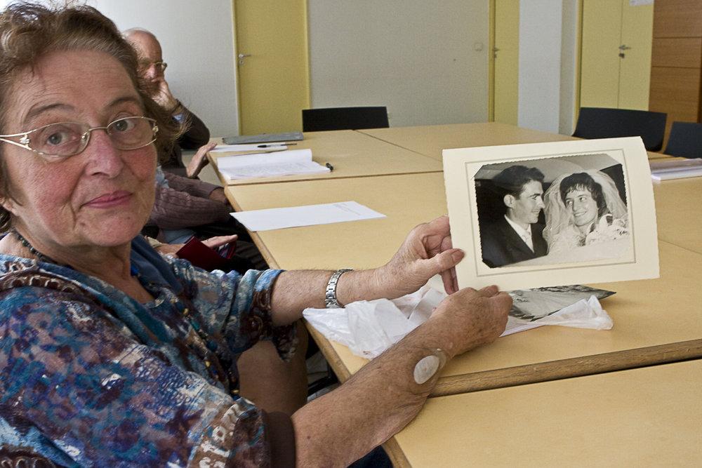 6763 Jane Showing Her Wedding Photo.jpg
