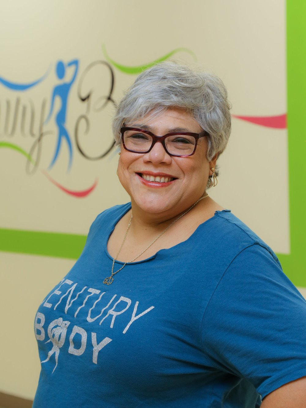 Eugenia Romero   I've been a staff member of Century Body for over 7 years. Like most at CB, I was a student first in a continuous journey to better health and Zumba® Fitness is the best way to work out without noticing. I love to dance and I love to sing to many of the songs. As a staff member, I love to welcome new folks into the studio and I always make sure to learn their names as I want them to know we are happy they've come to dance with us. My husband loves STRONG by Zumba®, and sometimes he would even come to a Zumba® Fitness class with me. A family that works out together lives happily. I'm working on learning to lead some songs as I also have my Zumba® license, so, hopefully in the near future, you'd see me leading a new song.
