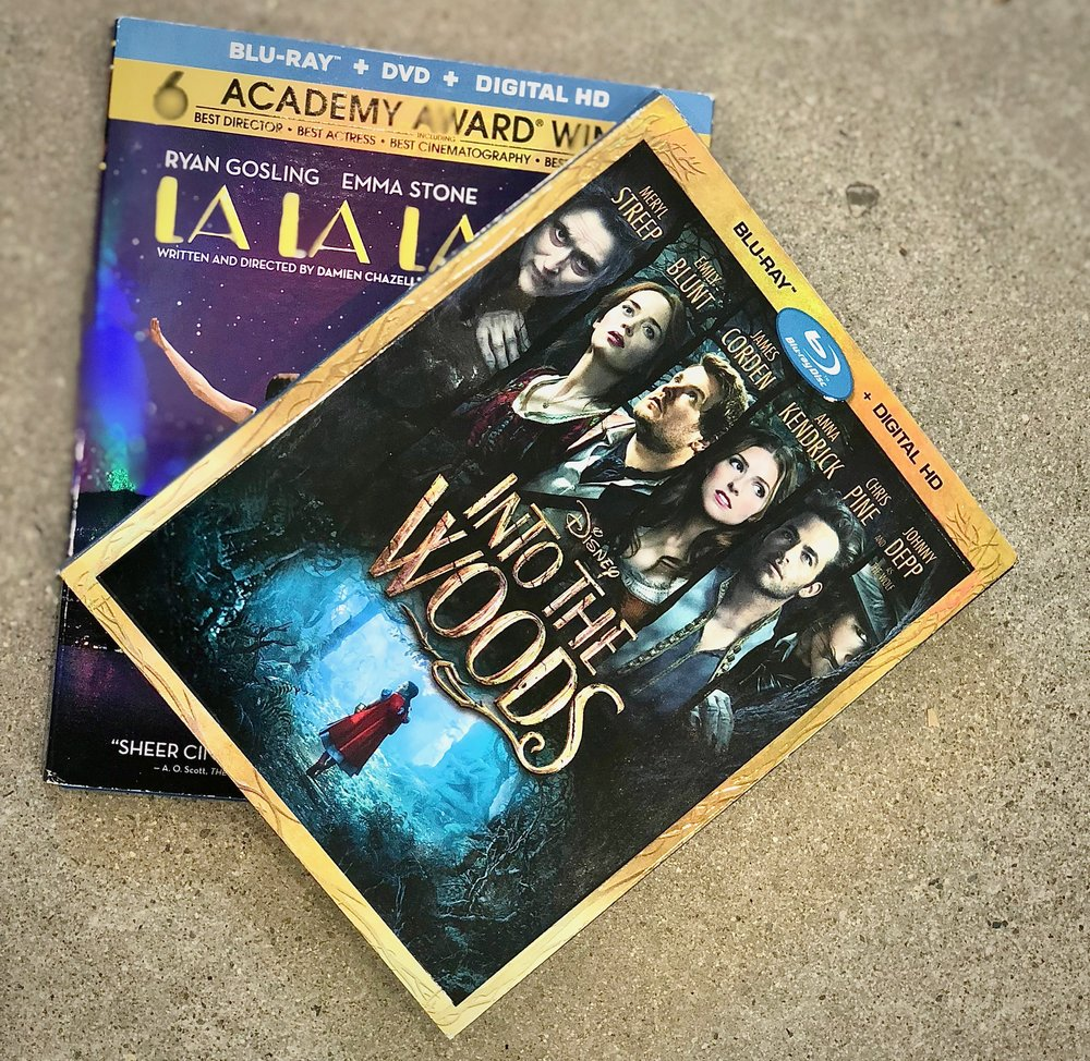 Win 1 copy of these hit musical movies on Blu-Ray. Disney's Into the Woods, and La La Land.