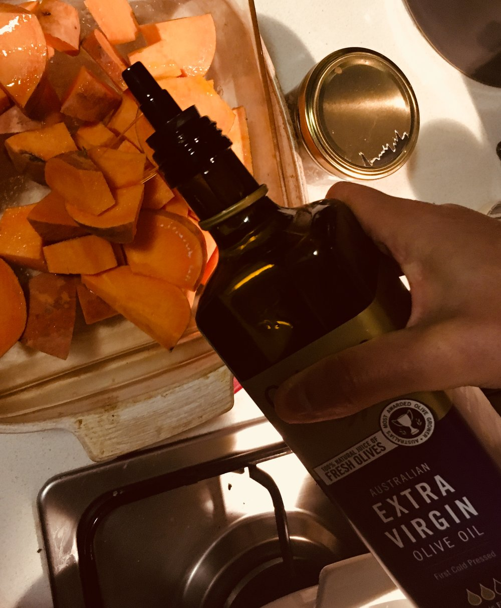 Oil & salt it! - Extra virgin olive oil instead of processed vegetable oils like canola oil is much better for you. Get your hands dirty and rub the sweet potato well with salt and oil.
