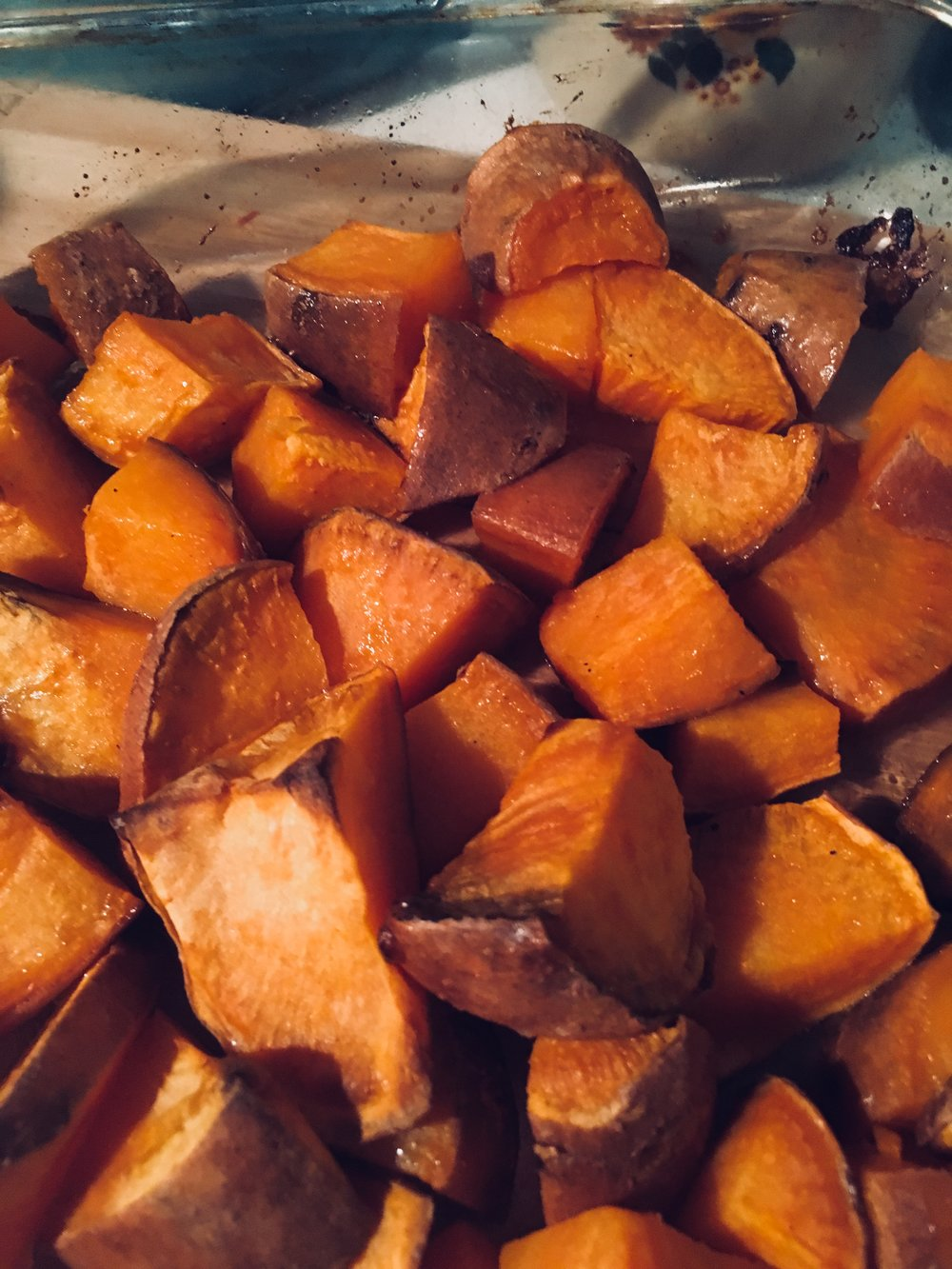 Roast it - have your oven nice and hot at 190 degrees, since the caramelisation of the sweet potato adds the flavour. The extra high heat, fan forced oven will ensure you get rid of the steam forming in the oven to ensure the nice caramelised flavour instead when the sweet potato browns. Give it 50 - 60 min and check till you are satisfied with colour and flavour.
