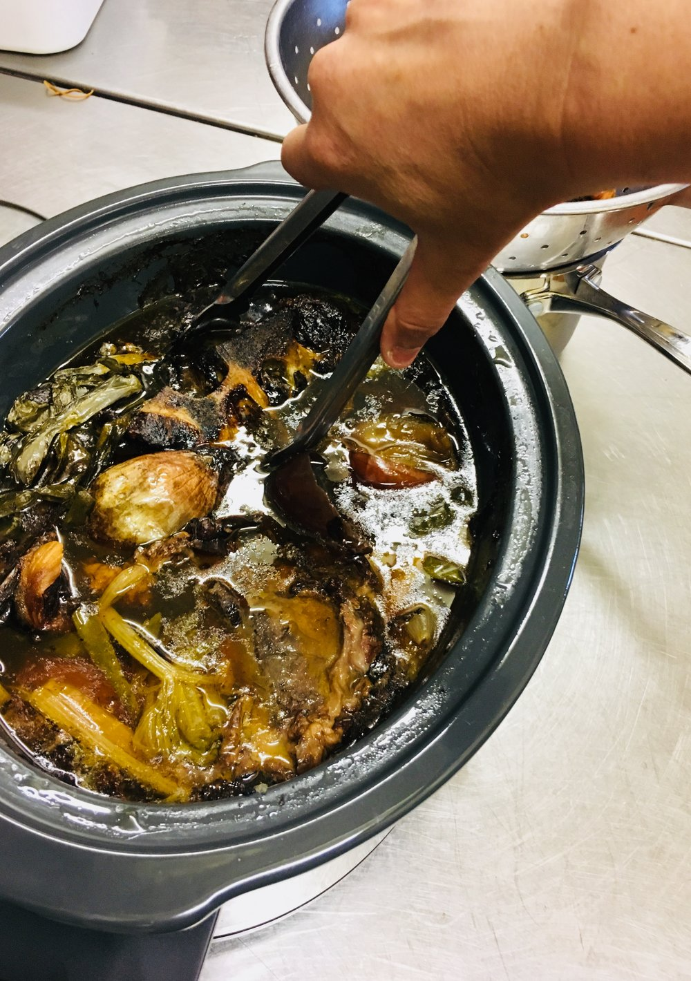 Avoid splatter by removing bigger bones first (tong's are my best friend)