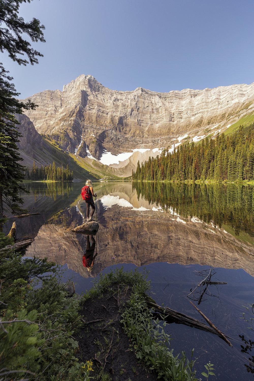 AJ enjoys the views and perfect reflection at Rawson Lake.