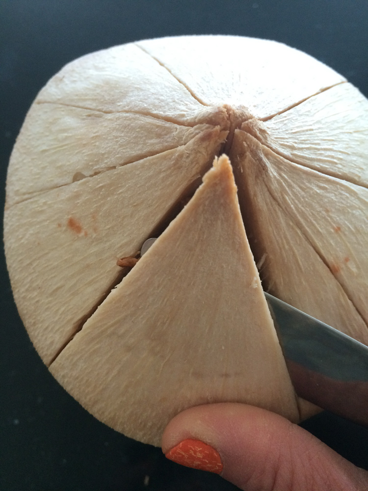 Cracking_Open_a_Coconut_Knife_Skin.jpg