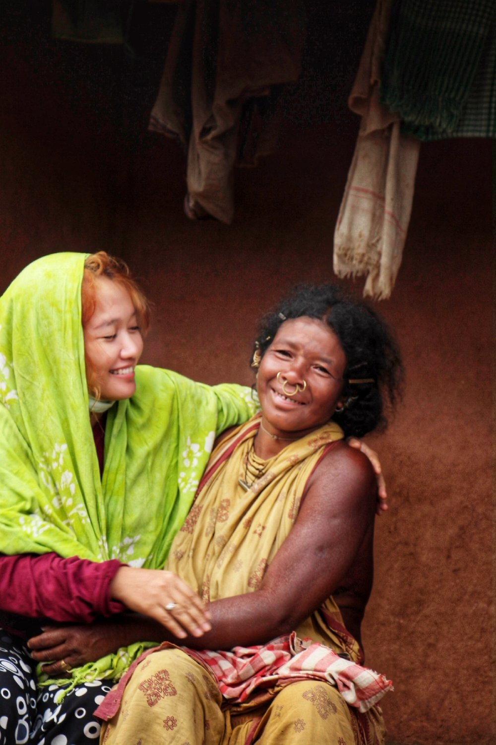 Laughing and showing affection toward each other despite the language barrier