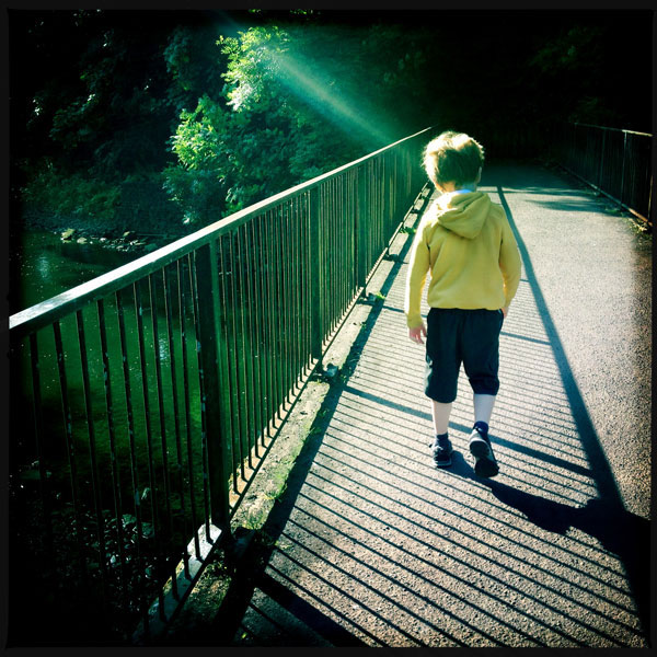 © Margaret Mitchell Photography: boy walking into distance