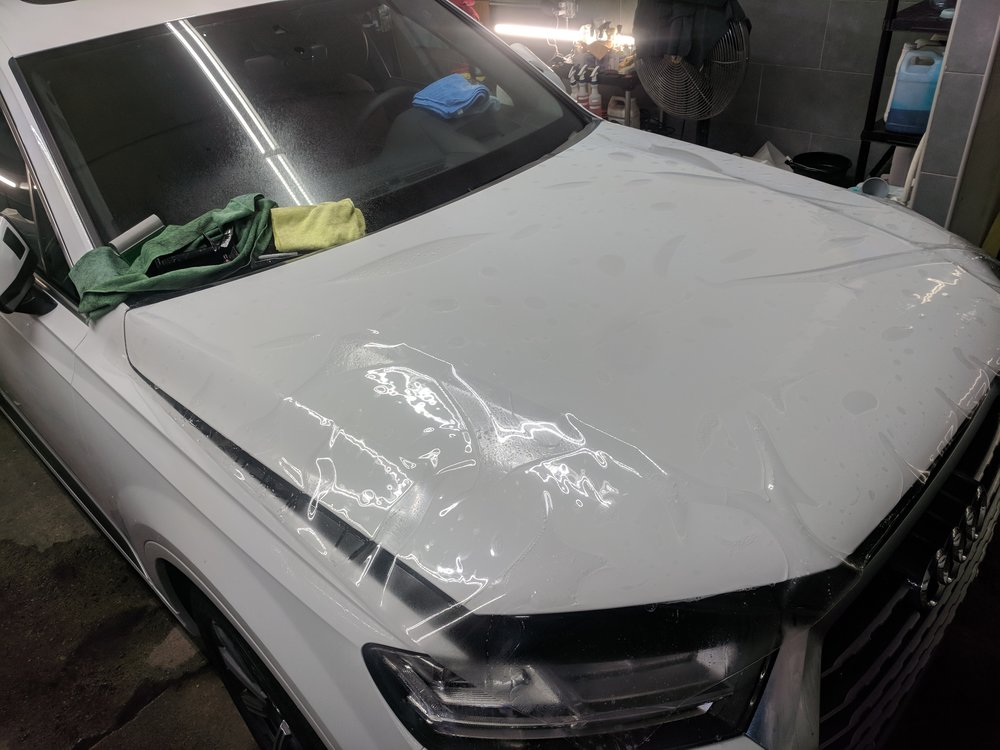 Audi Q7 full hood getting protected with Suntek Ultra paint protection film / clear bra