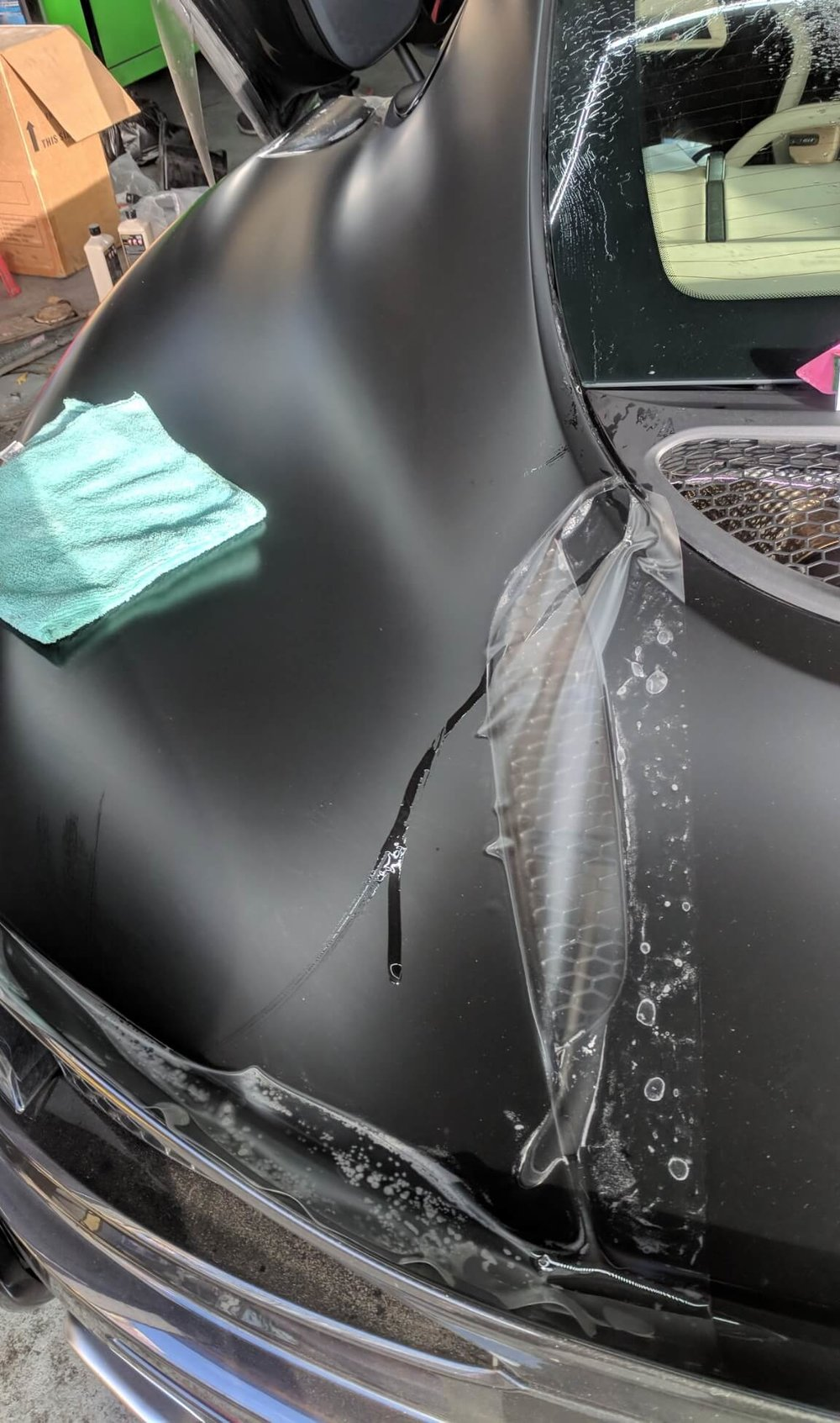 McLaren 570S rear quarter panel getting   Xpel Stealth paint protection film   / clear bra