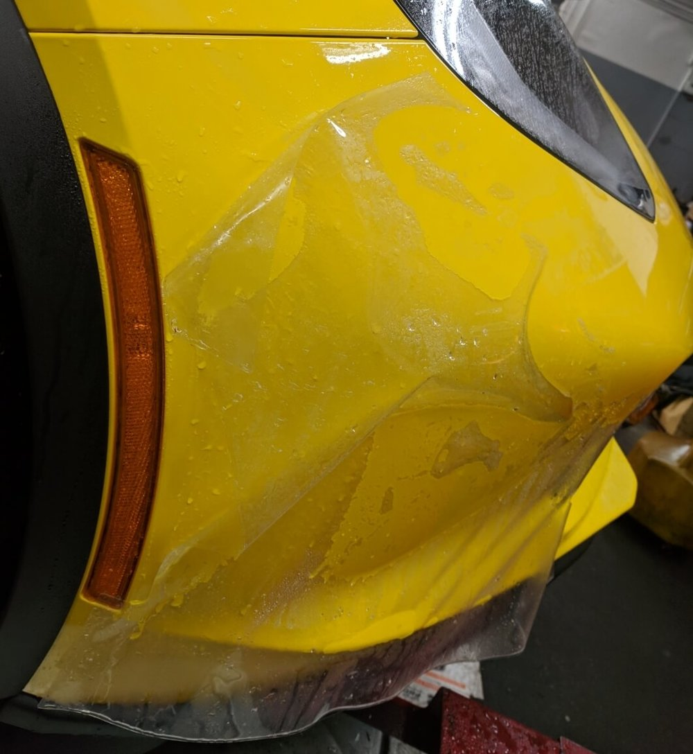 Corvette Z06 getting Xpel Ultimate paint protection film on front bumper