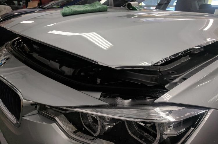BMW 320i complete hood getting Suntek Ultra paint protection film ( edges about to get wrap around the hood)