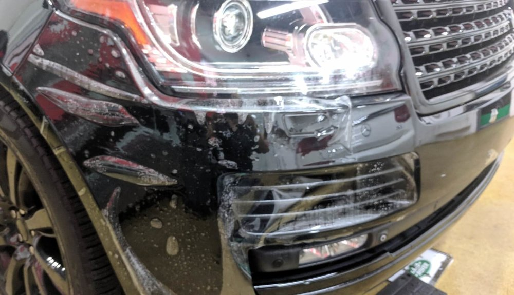 Range Rover HSE front bumper getting wrap with Suntek Ultra paint protection film / clear bra