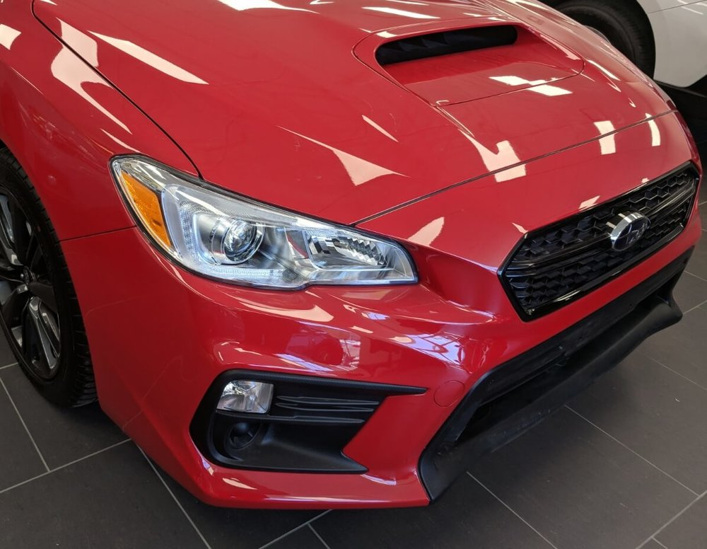 Subaru WRX front of hood, fenders, and front bumper protected with Suntek Ultra paint protection film