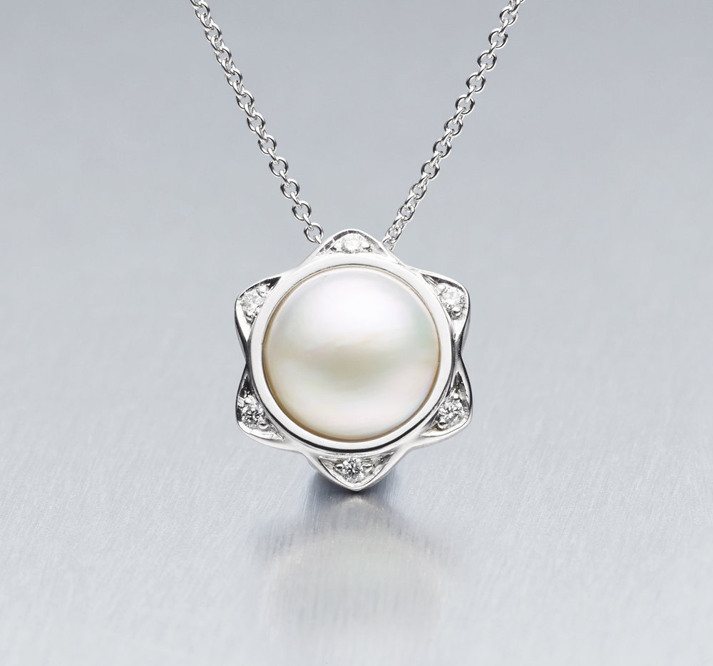 11. 'BUNDA Star' Mabe South Sea Pearl and Diamond Pendant
