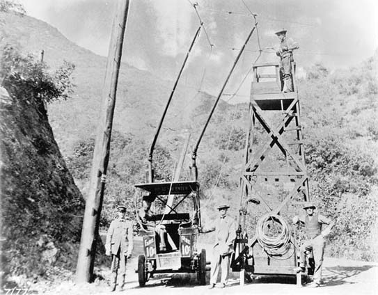 This was the nation's first trackless trolley, built by Charles Spencer Mann in 1910 to promote vacation lots in Laurel Canyon. The trolley ran along Laurel Canyon's dirt road and connected Sunset Boulevard to the base of the current Lookout Mountain Avenue where there was a small inn. The Laurel Tavern served lunch to tourists and prospective customers of Mann's Bungalow Land properties. The ride cost 10¢. More adventurous travelers could continue up Lookout Mountain Avenue for a breathtaking view of Hollywood from the area around the current Appian Way.