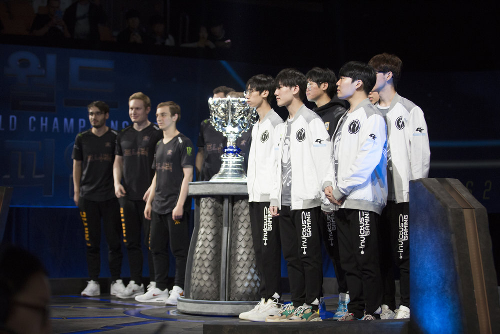 The final teams, Fnatic and Invictus Gaming on stage next to trophy at semifinals of the League Of Legends Worlds Championship on October 28, 2018 at the Gwangju Women's University Universiade Gymnasium in Gwangju, South Korea.  Photo by Timo Verdeil / ESPAT Media