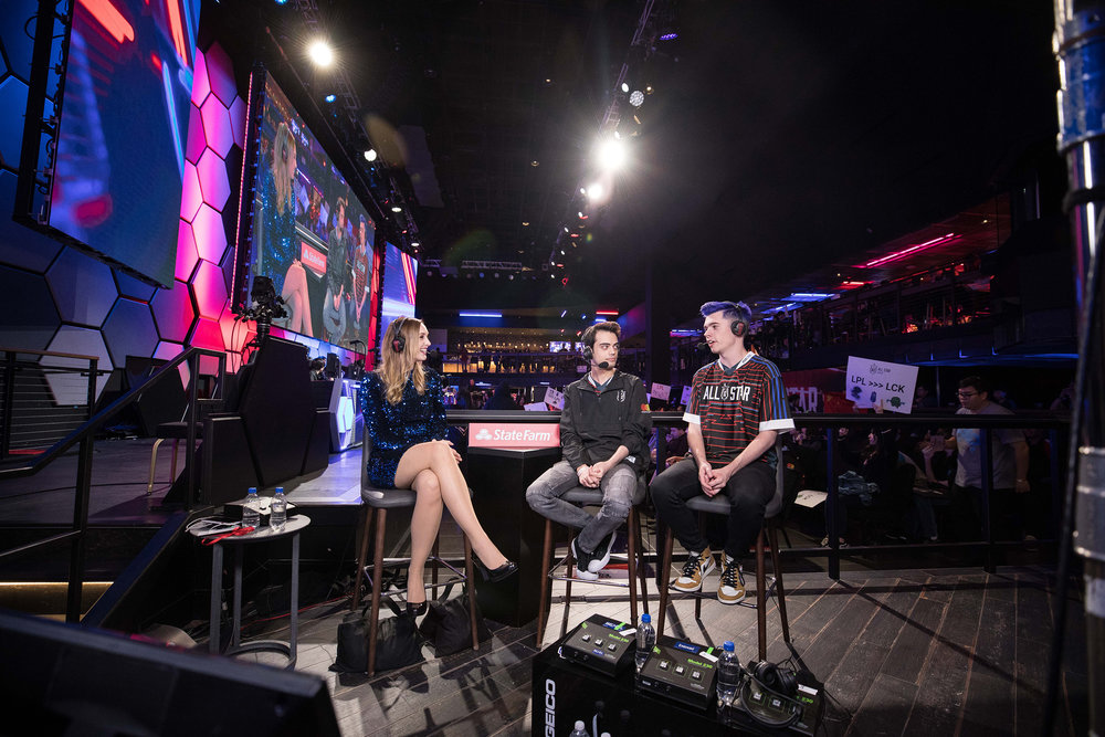 Esports caster talking to pro players onstage at League of Legends All-Star Event on December 8, 2018 in Las Vegas, Nevada.  Photo by Hannah Smith/ESPAT Media for Mastercard