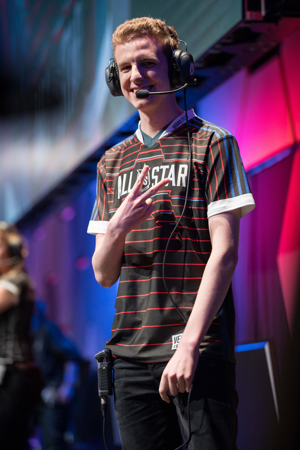 Esports pro player giving a peace sign to crowd onstage at League of Legends All-Star Event on December 8, 2018 in Las Vegas, Nevada.  Photo by Hannah Smith/ESPAT Media for Mastercard