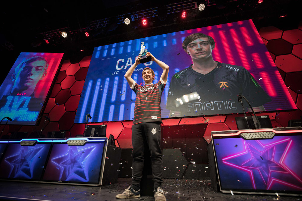 Rasmus 'Caps' Winther hoisting trophy onstage with confetti in background at League of Legends All-Star Event on December 8, 2018 in Las Vegas, Nevada.  Photo by Hannah Smith/ESPAT Media for Mastercard