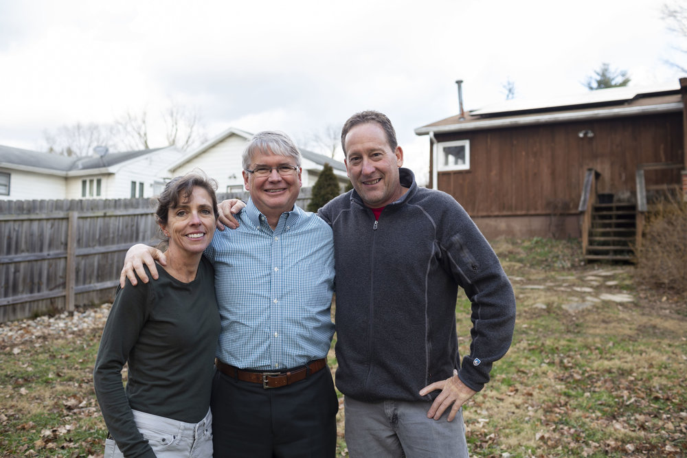 John with Kathy and Chris Gutowsky, Bloomington residents who recently installed solar panels on their home.