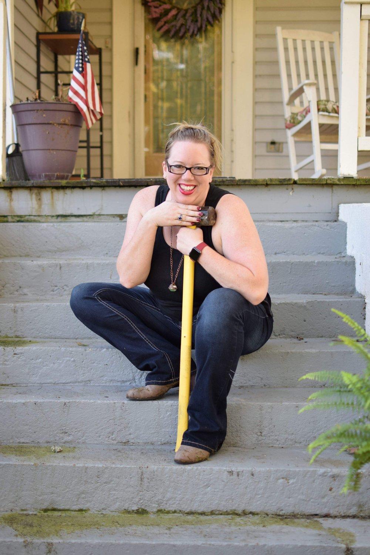 Bri Clark on Porch with Sledge Hammer