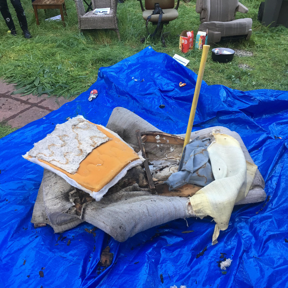 Jacq Greyja Read Poetry on March 16th 2019 in the Oak Center Neighborhood of West Oakland. After the reading, they stuck around while the audience destroyed this chair.