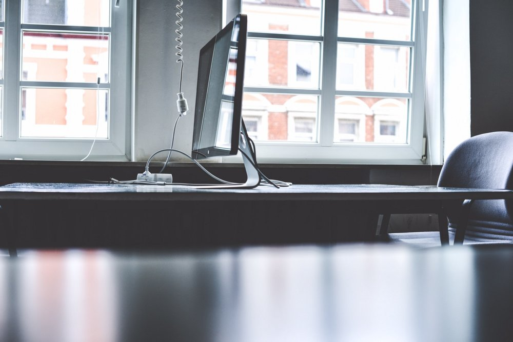 An empty desk with a monitor is what you will leave behind you most of the time.