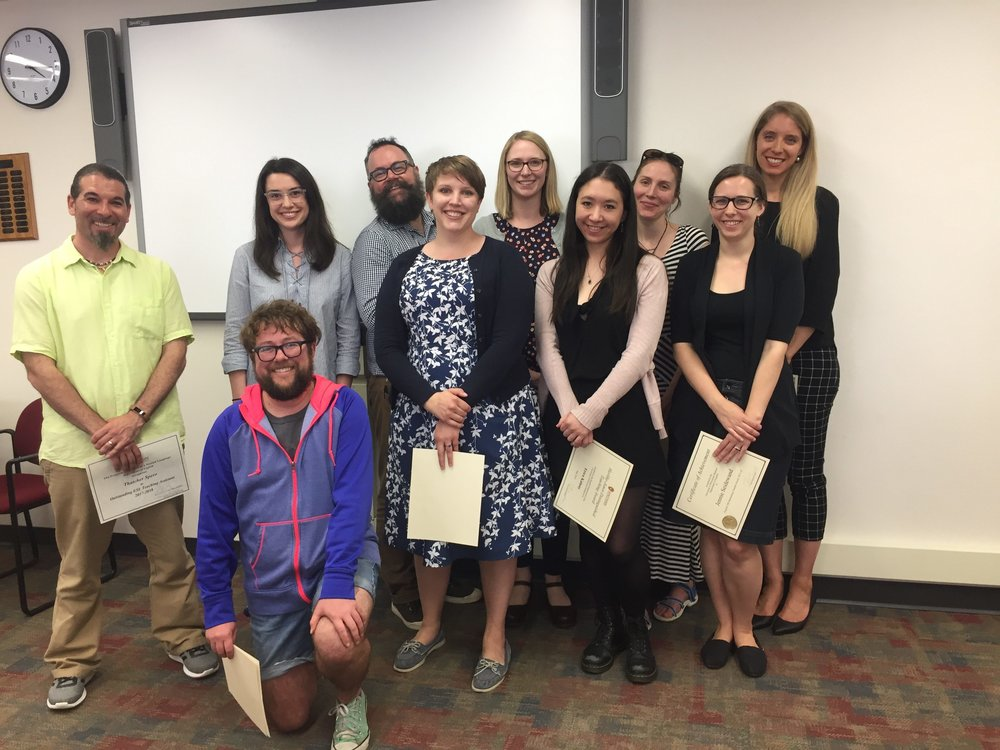 From left to right, some of the English Department TA Awardees: Thatcher Spero, Neil Simpkins (kneeling), Tori Thompson Peters, Scott Harman, Leah Parker, Annika Konrad, Erica Kanesaka Kalnay, Addie Hopes, Jennie Seidewand, Lindsey Wells.